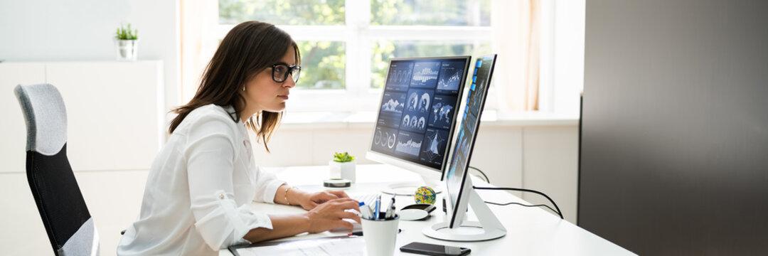 Analyst Women Looking At KPI Data