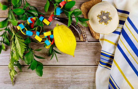 Jewish festival of sukkoth over paper colorful chain garland on kippah