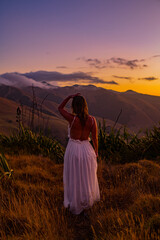 woman on a mountain at sunset
