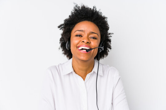 Young african american telemarketer woman isolated laughing and having fun.