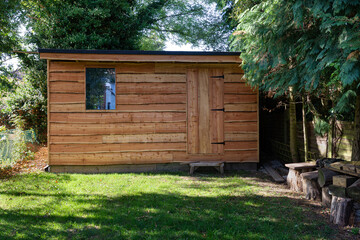 Fototapeta Waney edge wooden rustic garden shed. obraz