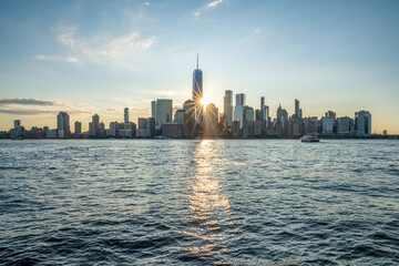 Lower Manhattan skyline with One World Trade Center at sunrise