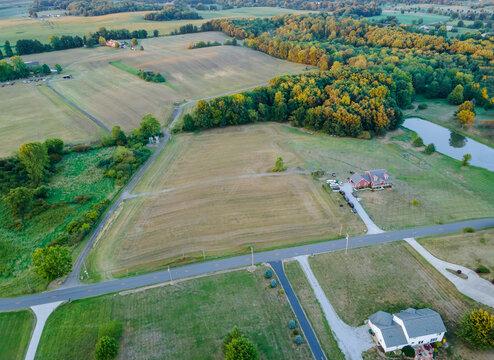 Amish farmland country farm, barn house on harvesting fields in fields in Hartville, Ohio