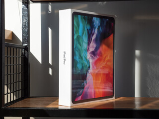 Penza. Russia - August 20, 2020: Packed Apple iPad Pro 2020. Diagonal 12.9 Inches. Tablet Computer on a Wooden Shelf.