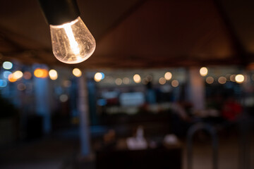 NYC outdoor dining light bulb portrait Fotomurales