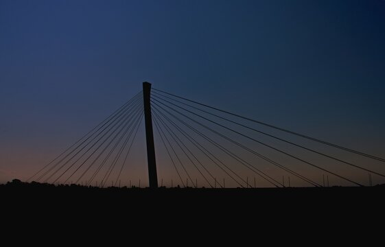 Silhouette of a new bridge in the town of Komárno / Slovakia /. The highest bridge on the Danube is in Komárno.