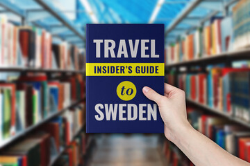 Travel insider's guide book to visiting Sweden with library on the background. Fotobehang