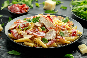 Chicken, bacon Penne pasta with parmesan cheese and basil. healthy food.