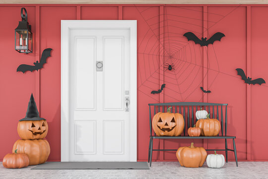 Carved pumpkins near white house door