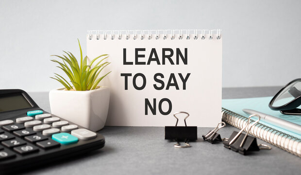 learn to say no - advice or reminder on a clipboard with a cup of coffee
