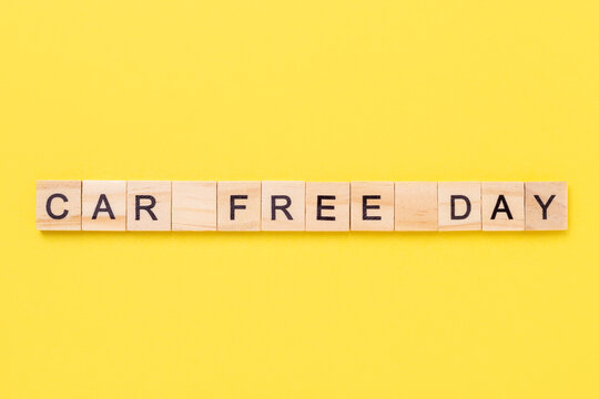 Text Car Free Day on yellow background. Concept of world car free day on September 22. Top view