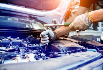 Car mechanic repair engine at service station. Car repair