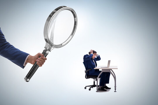Concept of employee monitoring by boss