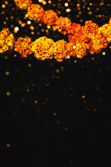 Marigold flowers Garlands and bokeh. Dia de los muertos day, day of the dead or halloween background, copy space