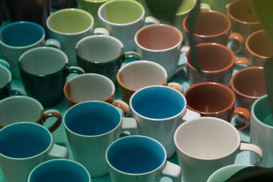 Various colors of ceramic coffee mugs a pattern