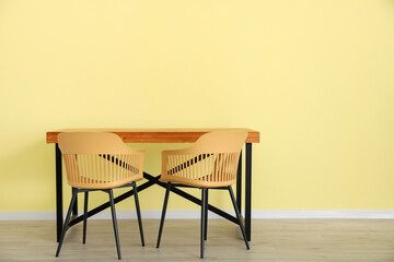 Dining table near color wall Papier Peint