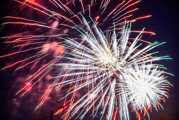 Colorful fireworks on the night sky. Explosions of pyrotechnics at festival