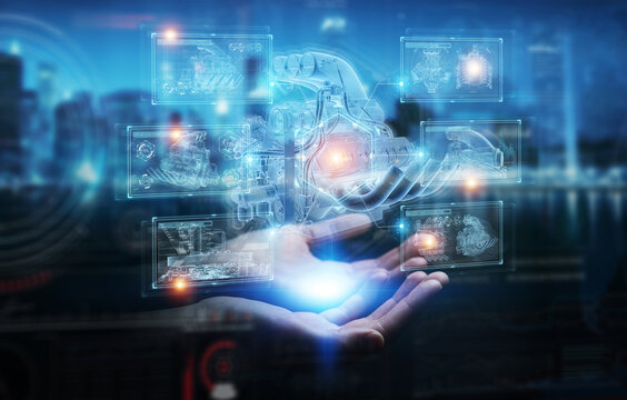 Businessman hand holding and touching wireframe holographic digital projection of an engine 3D rendering