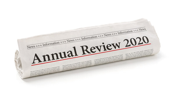 Rolled newspaper with the headline Annual review 2020