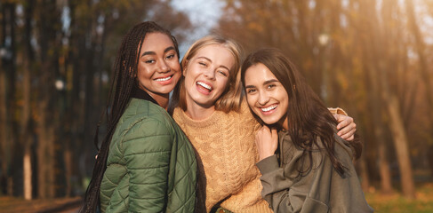 Portrait of three young girlfriends spending time in park