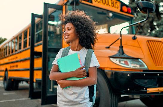 Girl near school bus