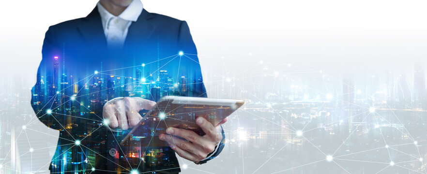 Double exposure business man using tablet on futuristic network connect city technology background