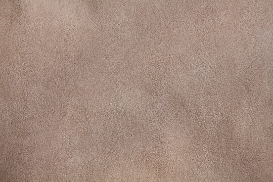 Beige suede leather texture. The cloth.
