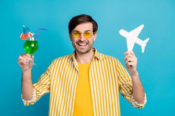 Photo of positive man traveler enjoy travel exotic trip hold alcohol beverage cocktail paper card...