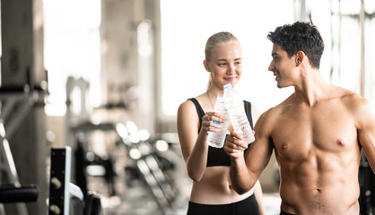 Gym fitness trainer concept, health lovers exercise in sports gym for a strong healthy body