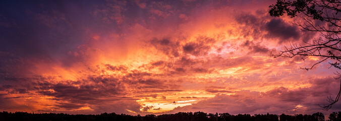 Colorful and dramatic sky panorama of sunset background