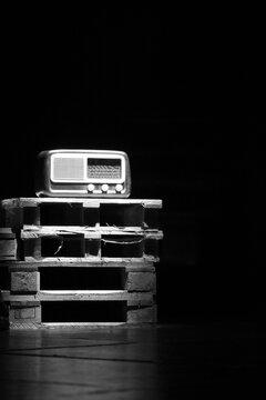 An Old Radio Vintage Over Wooden Pallets.