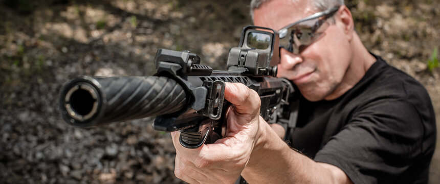 Front view gun point of rifle machine gun. Firearm shooting and tactical weapons training. Outdoor shooting range