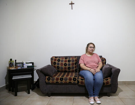 Web developer Darine Tamer poses for a picture in her house in Beirut