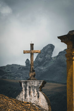 Cross By Building Against Sky