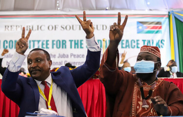 Yasir Arman, the deputy head of the Sudan People's Liberation Movement-North (SPLM-N) and secretary-general Ismail Khamis Jalab attend the signing of a peace agreement between Sudan's power-sharing government and five key rebel groups in Juba