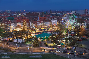 Erfurt, Germany. Christmas market on Domplatz (Cathedral Square) in dusk. View from Petersberg hill.