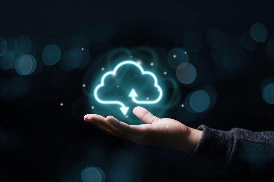 Businessman holding virtual cloud computing to transfer data information and upload download application. Technology transformation concept.