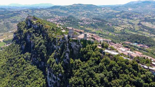 Aerial view of San Marino, an independant state in Northern Italy, photographed from a drone - Overview of Mount Titano and its famous three towers