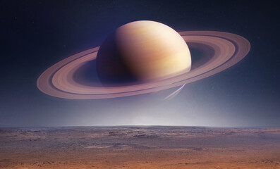 Landscape with saturn planet in sky with stars. Fantasy space wallpaper with planet over the land. Sci-fi. Elements of this image furnished by NASA