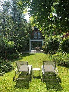 Sun loungers in a garden, London, England, UK
