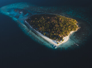 Aerial view of North Caye Island surrounded by turquoise water in Busuanga, Palawan, Philippines