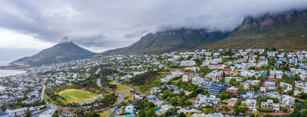 Panoramic aerial view of houses surrounded by mountains in Bakoven, Cape Town, South Africa
