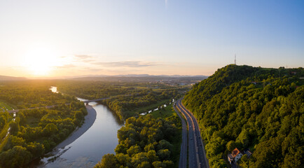 Panoramic aerial view of scenic sunset illuminating Sava river and Zagreb countryside, Croatia.