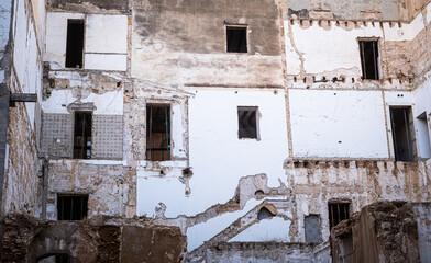 facade of a vacant damaged building