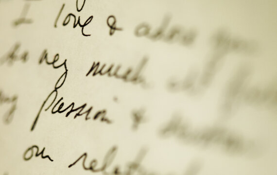 Cursive writing - words of love in a handwritten love note