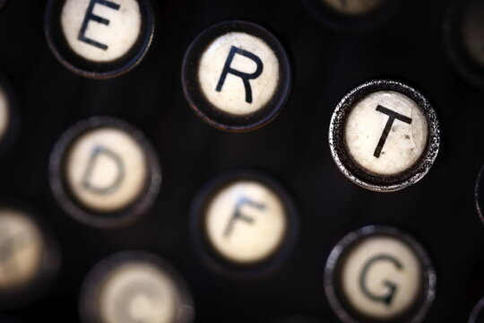 a close up of the keys of an old, antique, analog typewriter