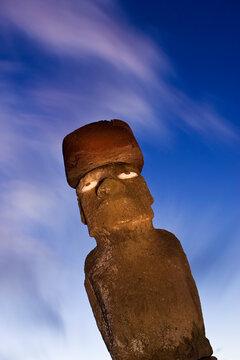 South America, Chile, Rapa Nui, Isla de Pascua (Easter Island), Moai statue Ahu Ko Te riku, the only topknotted and eyeballed Moai on the Island, illuminated at dusk