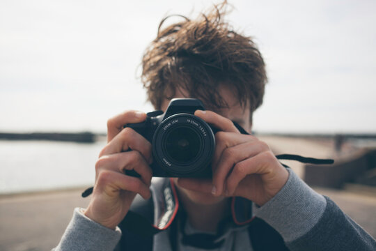 Young guy taking a photo with his camera