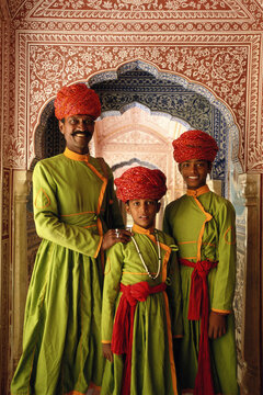 India, Jaipur, Samode Palace, father and sons in hallway, portrait
