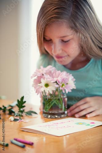 Mother's Day: Girl Makes Flower Arrangement for Mom
